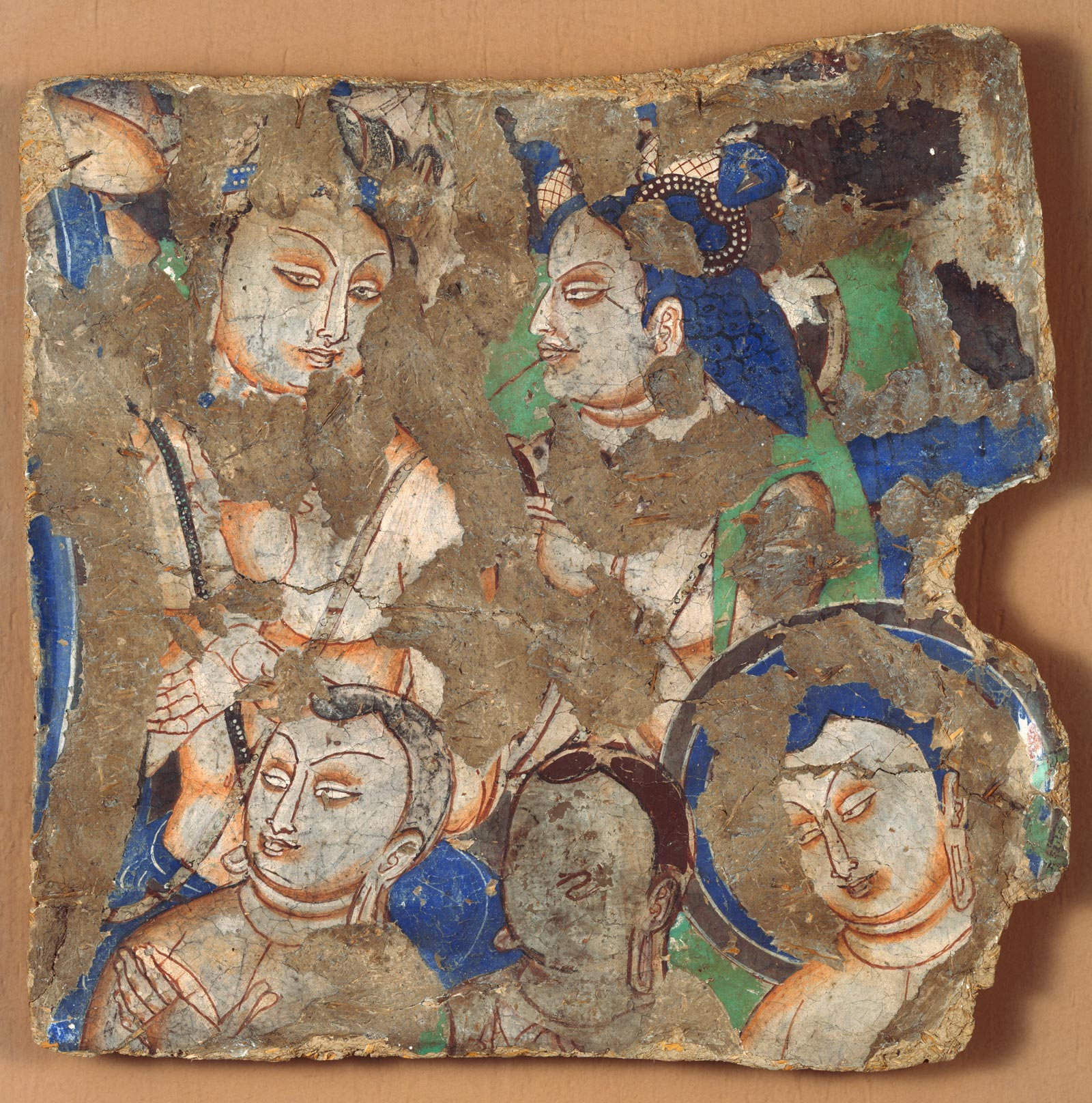 Mural fragment depicting an audience listening to the Buddha preaching